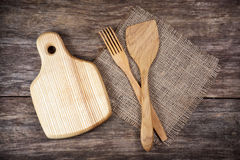 Empty chopping board and kitchen utensils Stock Photos