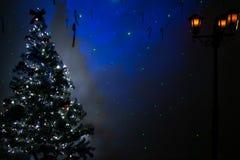 Empty christmas room with festive tree, lights vintage street lantern and blue stars stock photo