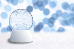 Empty Snow Globe With Blue background Stock Photo