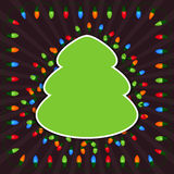 Empty Christmas tree with light bulbs on dark background Stock Photography