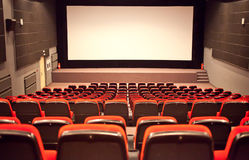 Empty cinema auditorium. With line of chairs and projection screen, ready for adding your own picture Royalty Free Stock Images