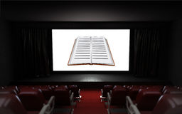 Empty cinema auditorium with book advertisement on the screen Stock Image