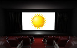 Empty cinema auditorium with ummer holiday advertisement on the screen Royalty Free Stock Images