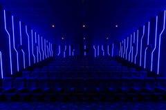 Empty cinema hall with blue light interior Stock Image