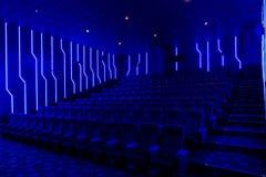 Empty cinema hall with blue light interior royalty free stock image