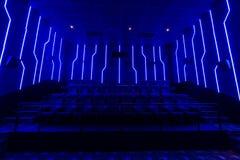 Empty cinema hall with blue light interior Royalty Free Stock Photos
