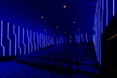 Empty cinema hall with blue light interior Royalty Free Stock Photography