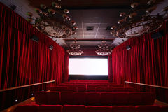 Empty cinema hall with large chandeliers and seats Stock Image