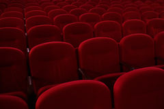Empty cinema hall. Rows of red chairs. The crisis in film distribution stock photography