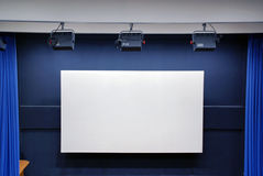 Empty cinema screen. With blue curtain Royalty Free Stock Photo