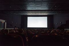 Empty cinema screen with audience Royalty Free Stock Images
