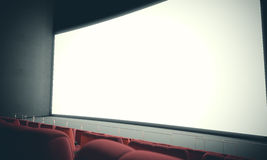 Empty cinema screen with red seats. With color filter. 3d render. Empty cinema screen with red seats. Ready for adding your for advertisement. With color filter Stock Photos