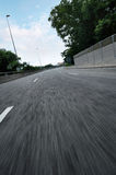 Empty city asphalt road with blue sky and motion blur Royalty Free Stock Images