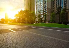 Empty road surface floor with City streetscape buildings Stock Image
