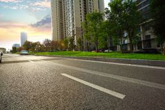 Empty road surface floor with City streetscape buildings Stock Photos