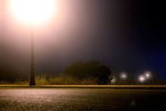 Empty city street at night. Empty street at night and lamppost stock photo