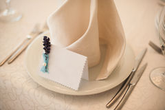 Empty classic white plate in  restaurant with a blank card for guest names. Royalty Free Stock Image