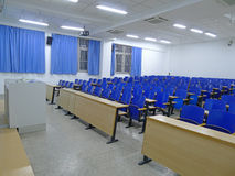 Empty classroom. With blue chairs Royalty Free Stock Photo