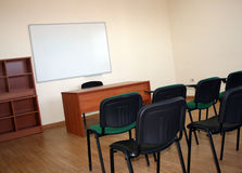 Empty Classroom. An empty classroom with a whiteboard and chairs Stock Photography