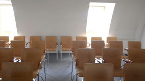 Empty classroom with chairs and desks stock video
