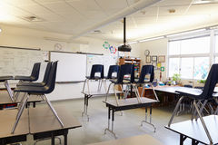 Empty classroom with chairs on tables Stock Images