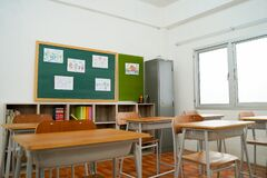 Empty classroom and desks preparation in primary school building in Asia. Elementary school interior
