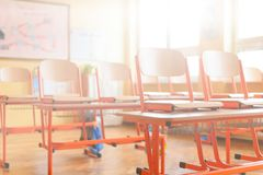 Empty classroom. Education concept. Empty classroom with school desks, chairs and blackboard. Education concept Royalty Free Stock Photos