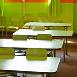 Empty classroom in a elementary. School with tables and chairs Stock Photo