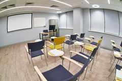 Empty classroom with сhairs and notepads Stock Photography