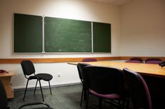 Empty classroom interior. Classroom interior with many red chairs and table Stock Photography