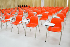 Empty classroom , orange chairs Royalty Free Stock Image