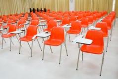 Empty classroom , orange chairs Royalty Free Stock Image
