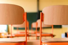 Empty classroom with school desks, chairs and blackboard. Education concept Royalty Free Stock Photos