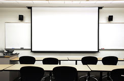 Empty classroom. With white board projector Royalty Free Stock Photos