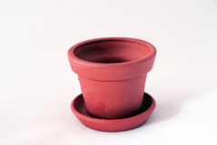 Empty clay pot. Empty red clay pot over white Royalty Free Stock Image
