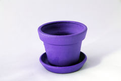 Empty clay pot. Empty violet clay pot over white Royalty Free Stock Photo