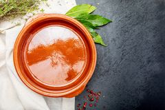 Empty clay pot with pepper, bay leaf and thyme. royalty free stock photo
