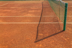 Empty clay tennis court. Empty red clay tennis court Royalty Free Stock Images