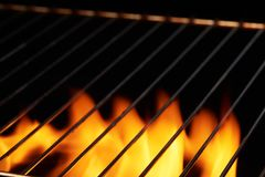 Empty clean black grill with flame Royalty Free Stock Photos