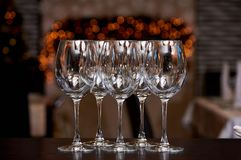 Empty clean glasses with reflection on a blurred background with bokeh royalty free stock photos