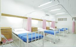 Empty clean and modern hospital room. stock photos