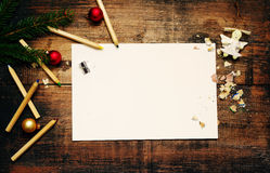 Empty clean sheet of paper for your inscription, pencils and Christmas decorations Stock Images