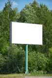 Empty clear billboard with trees mock-up. Empty clear billboard with copy space near the green trees. Can be used as mock-up stock image