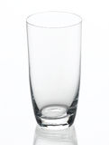 Empty clear glass isolated on white. Empty clear glass of milk or water the image isolated on white Royalty Free Stock Photo