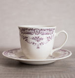 Empty clear vintage coffee cup with purple floral pattern Royalty Free Stock Photography