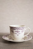 Empty clear vintage coffee cup with purple floral pattern Royalty Free Stock Photo