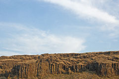 Empty Cliffs Under Blue Cloudy Skies Stock Images