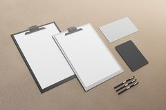Empty clipboard and supplies. On brown background. Document concept. Mock up, 3D Rendering Royalty Free Stock Photos