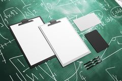 Empty clipboard and supplies. On chalkboard background. Document concept. Mock up, 3D Rendering Royalty Free Stock Photo