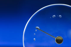 Empty clock lid with drop Stock Image
